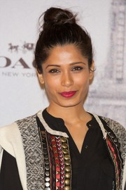Freida Pinto looked sassy with her top-knot during the Coach boutique opening.