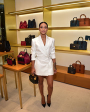 Karrueche Tran styled her dress with a boxy purse by MCM.