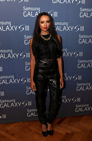 Kat Graham exuded radiant beauty in a sleek all-noir jumpsuit with shiny geometric accents.