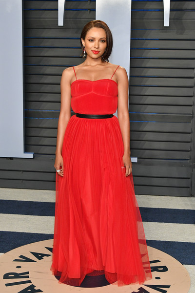Kat Graham Evening Dress [oscar party,vanity fair,fashion model,clothing,dress,shoulder,gown,fashion,red,bridal party dress,formal wear,cocktail dress,beverly hills,california,wallis annenberg center for the performing arts,radhika jones - arrivals,radhika jones,kat graham]