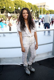 Kat Graham went for funky sophistication in a crystal-studded jumpsuit during the Unilever ice skating event.