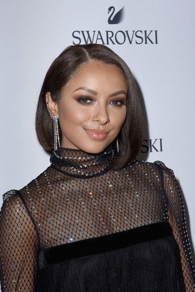 Kat Graham Asymmetrical Cut [photo,hair,hairstyle,beauty,eyebrow,shoulder,neck,fashion,lip,dress,brown hair,kat graham,swarovski,caption,the grove,california,los angeles,getty images,holiday celebration,holiday collection launch]