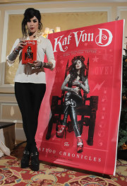 Kat Von D added edge to her look with black leather ankle boots boasting major platforms.