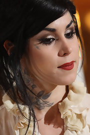 Kat Von D showed off sultry red lips while presenting her latest book,'The Tattoo Chronicles'.