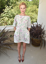 Kate Bosworth finished off her lovely ensemble with a pair of red ankle-tie pumps by Bionda Castana.