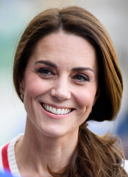 Kate Middleton Loose Ponytail [hair,face,eyebrow,hairstyle,facial expression,smile,chin,skin,lip,nose,prince william,duchess,part,belfast,duchess of cambridge,cambridge,northern ireland,national stadium,duke,day one,catherine duchess of cambridge,william catherine: a royal romance,wedding of prince william and catherine middleton,belfast,image,photograph,duchess of cambridge,celebrity,eyebrow]