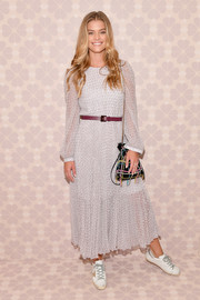 Nina Agdal went modest in a long-sleeve gray maxi dress by Kate Spade during the brand's Spring 2019 show.