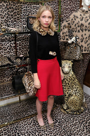 Tavi Gevinson finished off her well-coordinated look with a leopard-print faux-fur bag by Kate Spade.