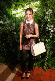 Jamie Chung topped off her ensemble with a simple cream leather tote by Kate Spade.