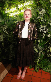Elisabeth Moss' floral leather jacket at the Kate Spade presentation was a perfect blend of sweet and edgy.
