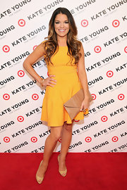 Sabrina Soto chose a bright tangerine A-line for her red carpet look at the Kate Young for Target launch.