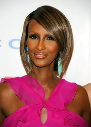 At the DKMS 5th Annual Gala, Iman wore edgy, smoky eye makeup that contrasted beautifully with her ultra feminine blouse and colorful earrings.