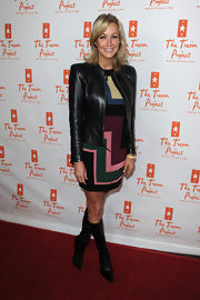 Lara Spencer paired a mod mini dress with black knee high boots. The leather boots looked fab with her sleek leather jacket.