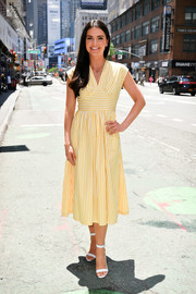 Katie Lee paired her cute dress with white ankle-strap sandals.