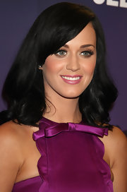 Katy Perry was on site to promote her new fragrance 'Purr'. She completed her satin Miu Miu dress with classic medium length waves.