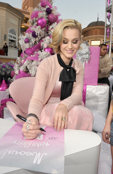 Katy Perry Cardigan [pink,fashion,leg,blond,dress,sitting,plant,fashion design,fashion accessory,flower,katy perry,katy perry launches,meow,autographs,california,los angeles,the grove,nordstrom]