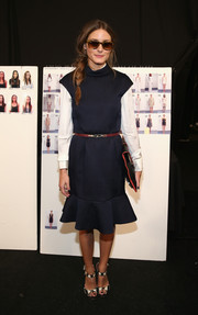 Olivia Palermo was sporty-chic at the Kaufmanfranco fashion show in a navy and white dress with a flared hem.