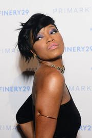 For her plump kissers, Keke Palmer chose a sweet pink hue that went beautifully with her purple eyeshadow.