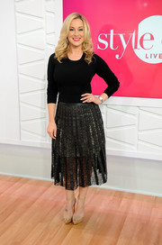 Nude ankle-strap sandals with gold platforms finished off Kellie Pickler's chic attire.