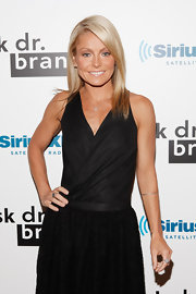 Kelly Ripa wore her shiny, flaxen locks super straigh at Dr. Fredric Brandt's SiriusXM launch event. To keep tresses lustrous, we recommend  a product like ALTERNA Caviar Anti-Aging Rapid Repair Spray.