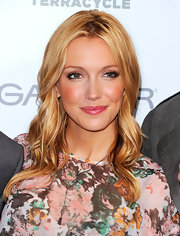 Katie Cassidy paired her floral top with a pop of pink gloss. Shimmering metallic shadow completed her look.