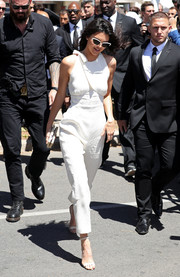 Kendall Jenner was summer-chic in a sleeveless white jumpsuit by Emilia Wickstead while attending the Magnum Global Ambassador photocall.