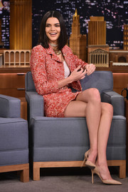 Kendall Jenner went for simple styling with a pair of nude patent pumps by Manolo Blahnik.