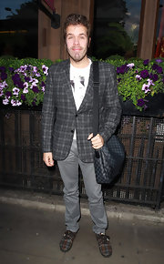 Never mind the clashing prints, Perez Hilton paired a Louis Vuitton messenger bag with his plaid jacket at the launch of the Kensington Club.