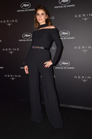 Clotilde Courau looked sophisticated in a black off-the-shoulder jumpsuit with choker detail at the Kering Women in Motion Awards.