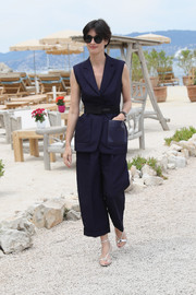 Paz Vega styled her look with strappy silver sandals.
