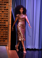 Kerry Washington paired her fabulous dress with pink velvet sandals by Chloe Gosselin.