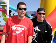 Adam Sandler paired his printed T-shirt with modern rectangle shades.