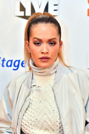 Rita Ora styled her hair into a tight ponytail for Key 103 Live.