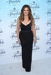 Khloe Kardashian showed major cleavage in a low-cut, tight-fitting black camisole by L'Agence during the HPNOTIQ launch.