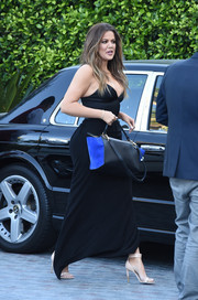 Khloe Kardashian arrived for the HPNOTIQ launch lugging a stylish blue and black tote.