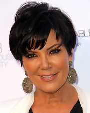Kris Jenner loves her jewels. The 14-karat gold and 16-carat diamond earrings  really stood out when paired with her cropped cut.