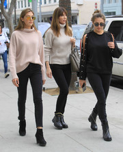 Sistine Rose Stallone completed her outfit with black suede ankle boots.