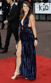 Alison Carroll looked oh-so-sultry in a back, cleavage, and thigh-baring navy halter dress.
