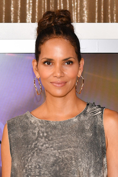 Halle Berry spiced up her look with a pair of oversized gold hoops.
