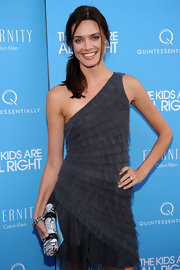 Looking fresh-faced and happy, Daniella walked the red carpet in a tulle, tiered, one shoulder cocktail dress with a messy side ponytail and a printed clutch.