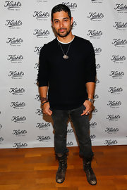 Wilmer Valderrama chose this black crewneck sweater to top off his look while at a charity event in Santa Monica.