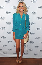 Stephanie Pratt is bold blue in a silky bright shirt dress with over sized pockets.