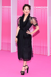 Sandra Oh complemented her dress with black platform sandals by Neil J. Rodgers.