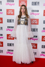 Jodie Comer went for medieval glamour in a loose white lace gown with a sequined bodice at the London premiere of 'Killing Eve' series two.