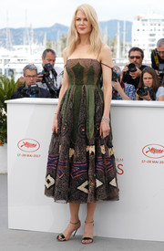 Nicole Kidman complemented her dress with metallic-green ankle-strap sandals, also by Dior.