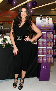 Khloe showed off her tiny waist with an oversized black patent leather belt featuring the designer's double 'C' logo.