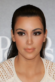 At the Kardashian Kollection handbag launch in Sydney, Kim Kardashian's eyes were made up with a palette of subtle, neutral shades. She still went for lots of liner, mascara and a pair of lengthy false lashes.