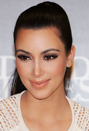 Kim Kardashian wore a shiny golden peach gloss to promote Kardashian Kollection handbags in Australia.