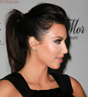 Kim Kardashian paired her voluminous ponytail with sparkling diamond studs.