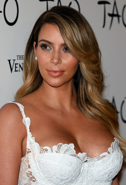 Kim Kardashian Feathered Flip